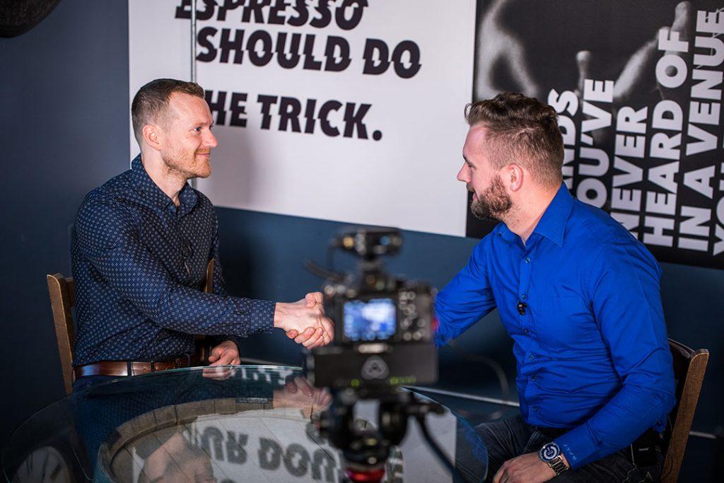 Kyle Shewfelt shaking Jon Hafichuk's hand at Gravity Cafe